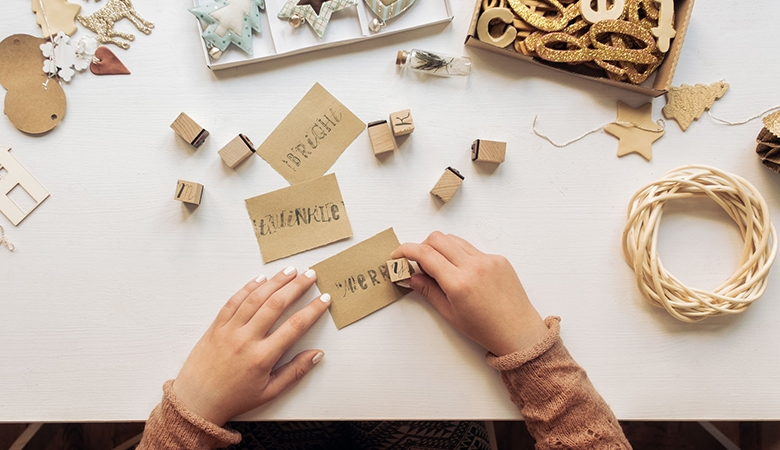 Woman making holiday cards