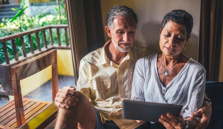 Couple looking at an tablet