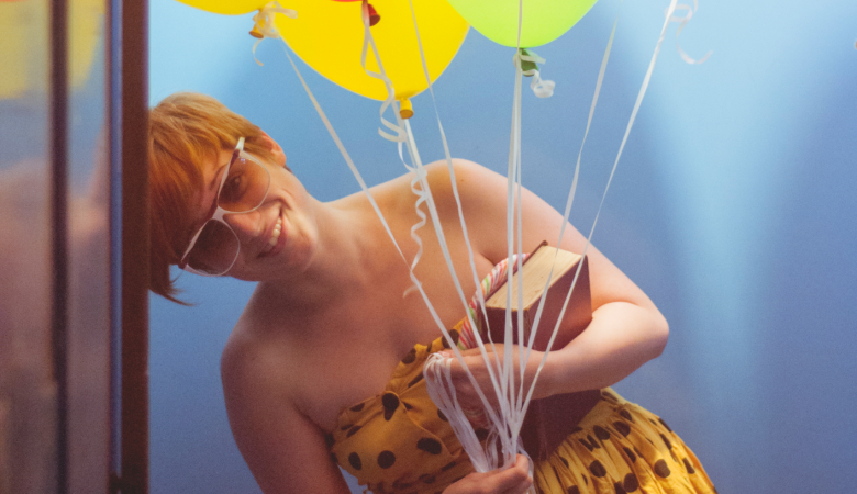 Young woman with balloons in an elevator