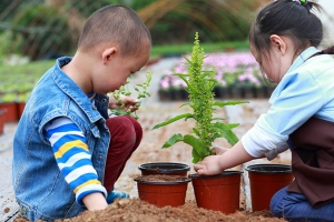 Two kids planting