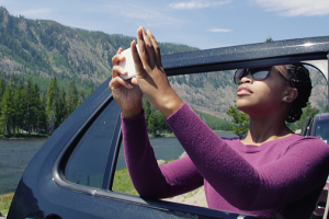 woman taking a photo out her car window