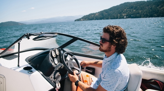 Man driving boat on lake