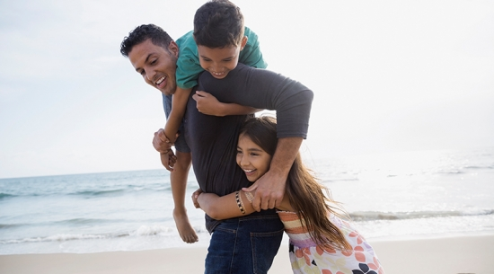 Dad with two kids at beach