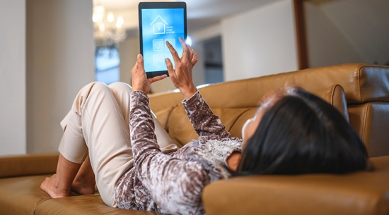 Woman using smart home tablet