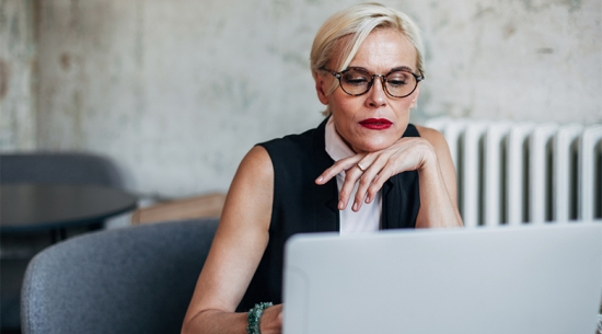 Business woman in her 40s on laptop