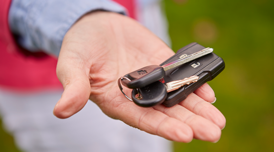 hand with new car keys