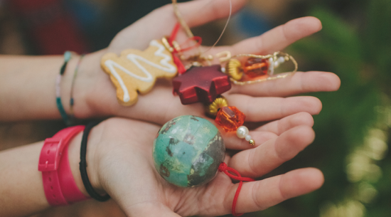 Hands holding Christmas ornaments