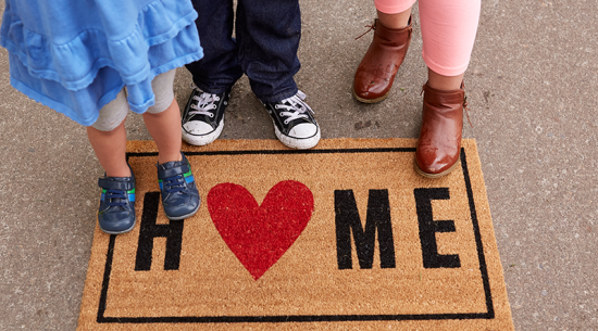 welcome home door mat with kids feet
